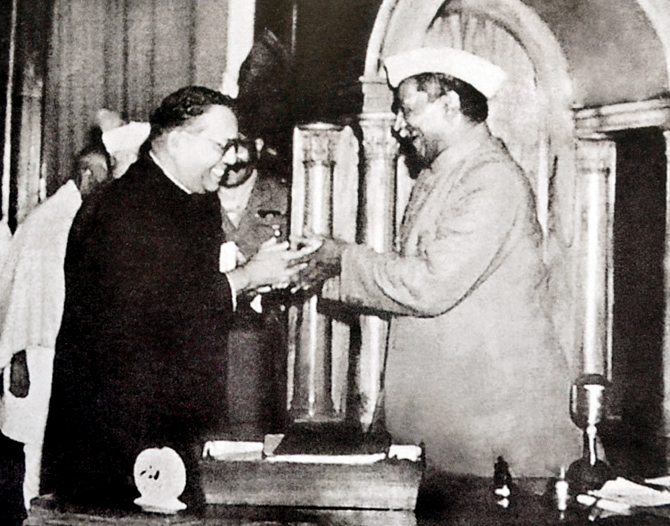 Dr._Babasaheb_Ambedkar,_chairman_of_the_Drafting_Committee,_presenting_the_final_draft_of_the_Indian_Constitution_to_Dr._Rajendra_Prasad_on_25_November,_1949
